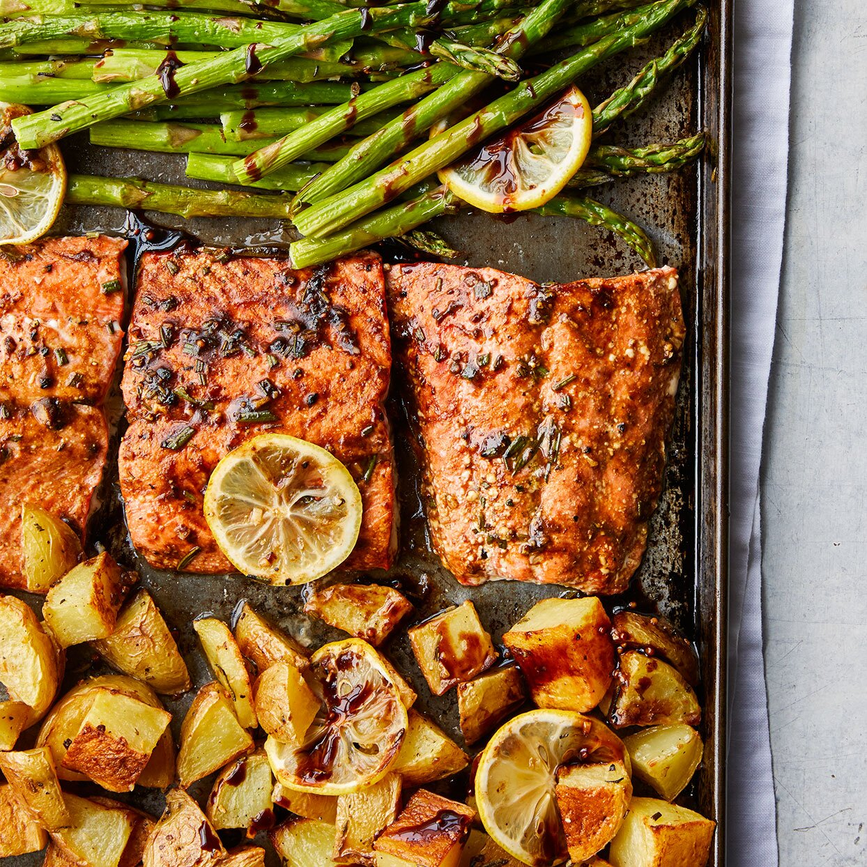 Sheet pan of the Rosemary Roasted Salmon with Asparagus & Potatoes recipe