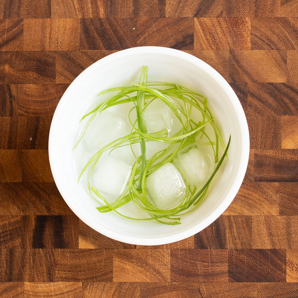 green onion curls in a bowl