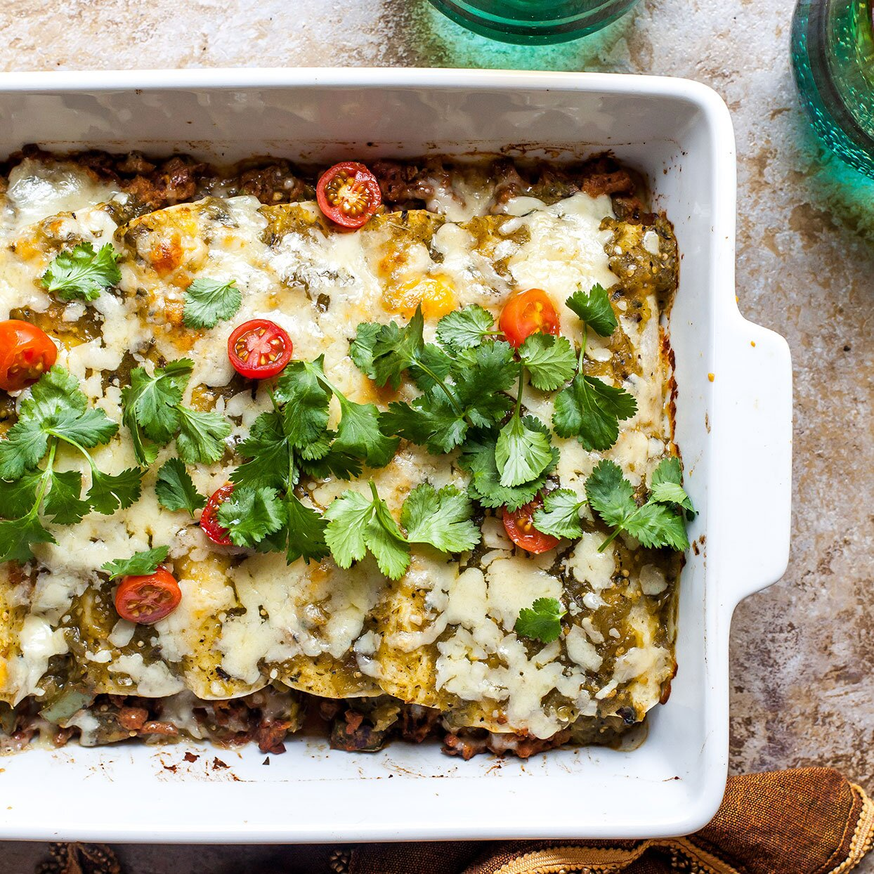 enchiladas in a white pan on a table