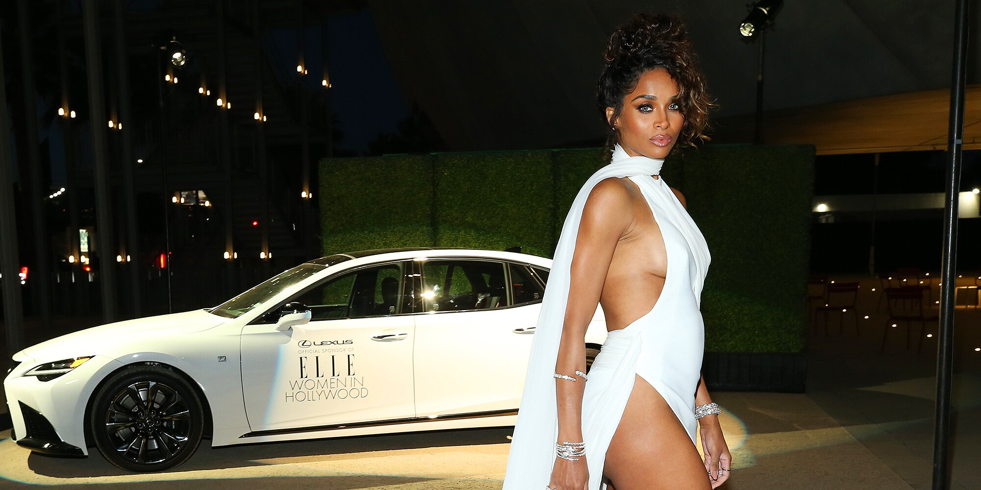 Ciara Wows in All-White Gown with Thigh-High Slit at the 27th Women in Hollywood Celebration