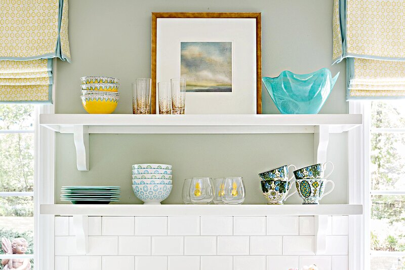 Shelving display in kitchen with cups and bowls