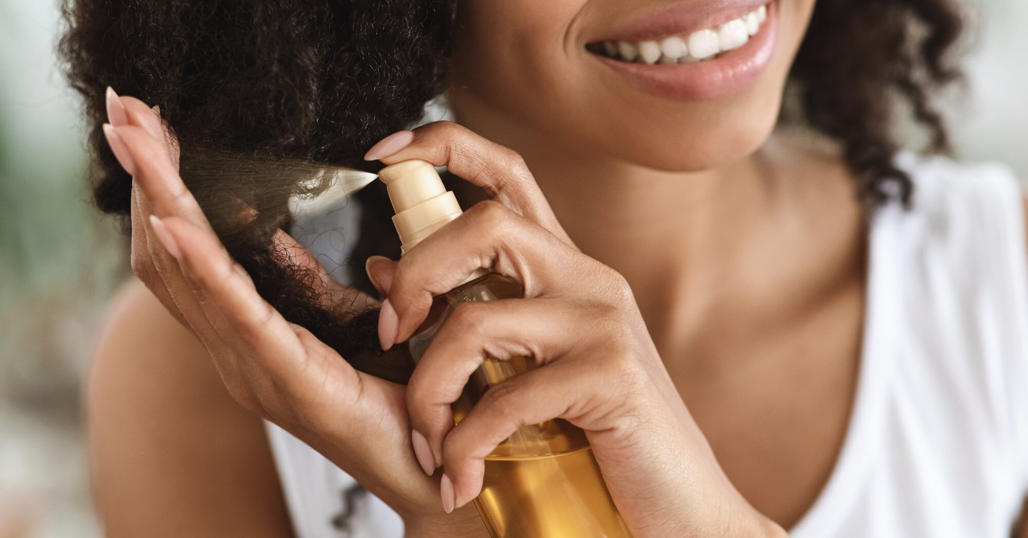 How Essential and Carrier Oils Benefit Your Hair, According to an Expert