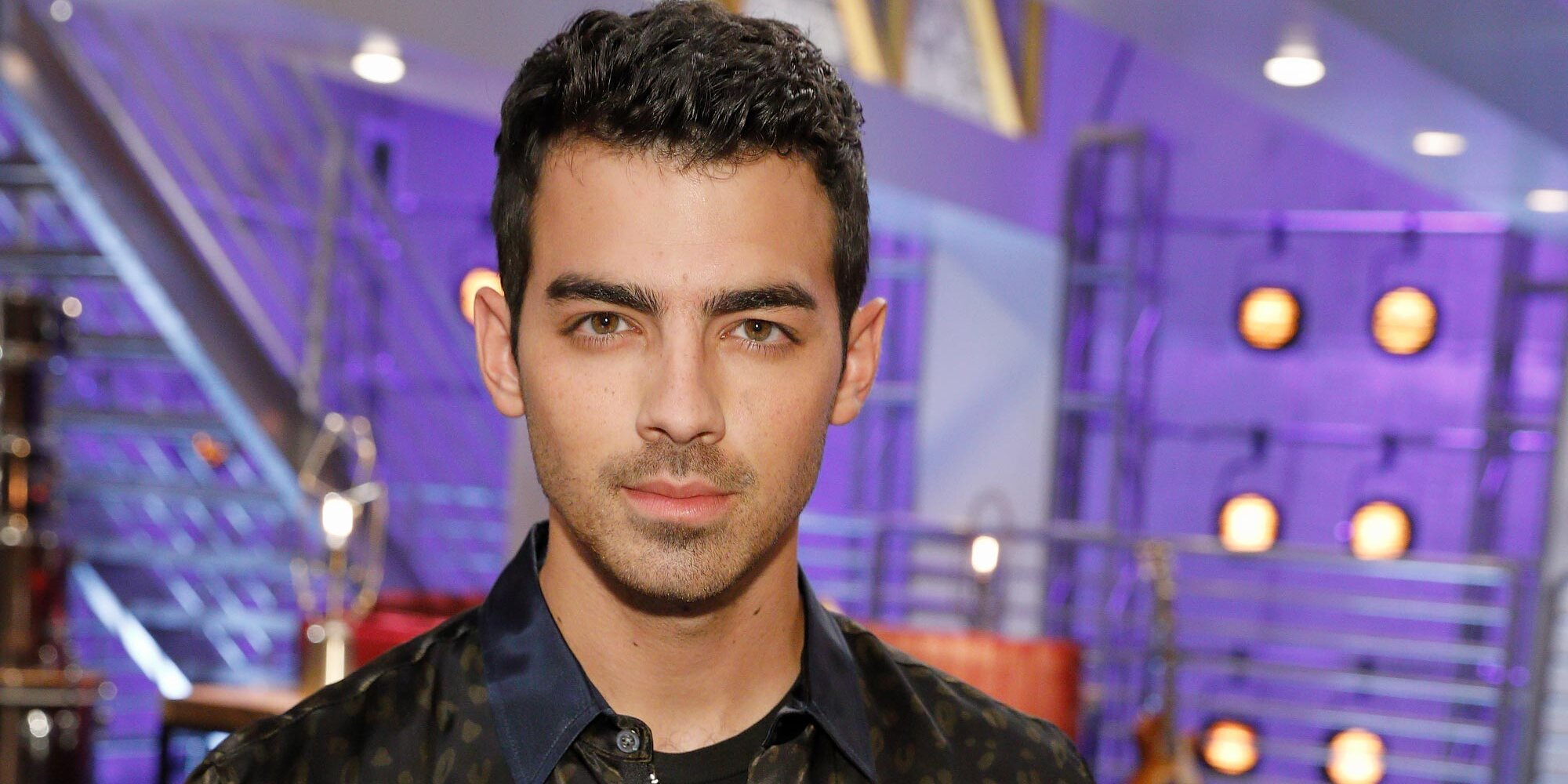 Joe Jonas wants to give you a hand — literally — to ease your COVID travel anxiety.jpg