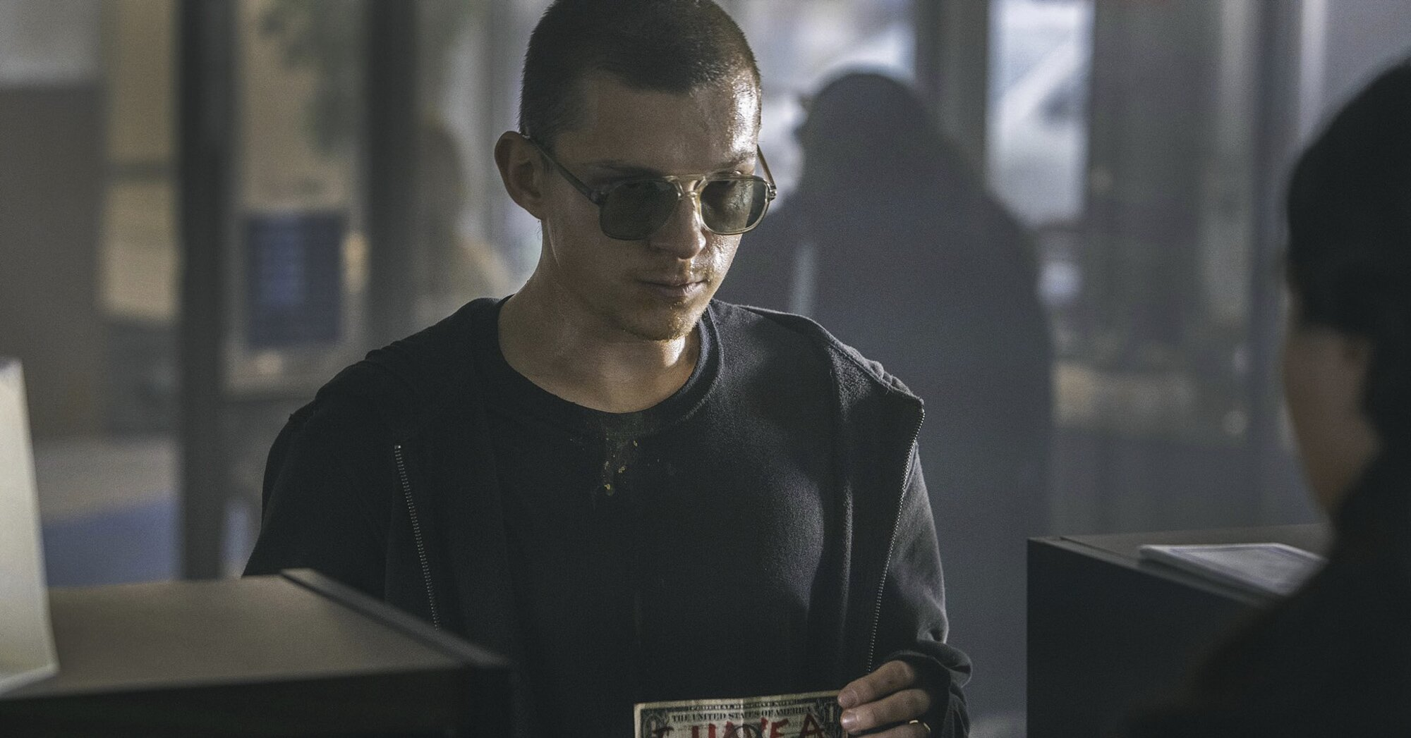 War-weary Tom Holland becomes a bank robber in new 'Cherry' photos