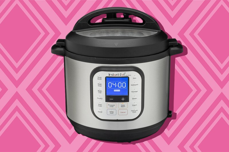 A silo of an Instant Pot on a pink patterned backgound