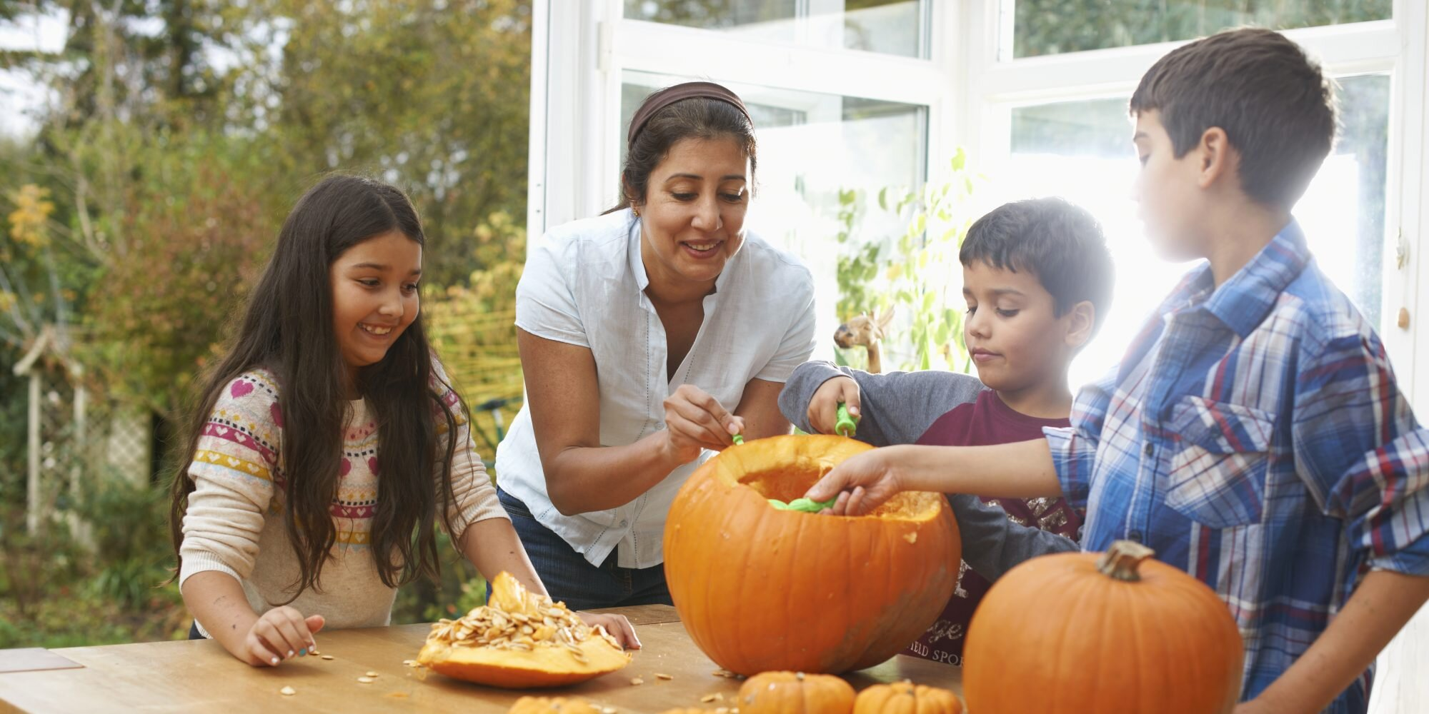 host a family pumpkin carving night