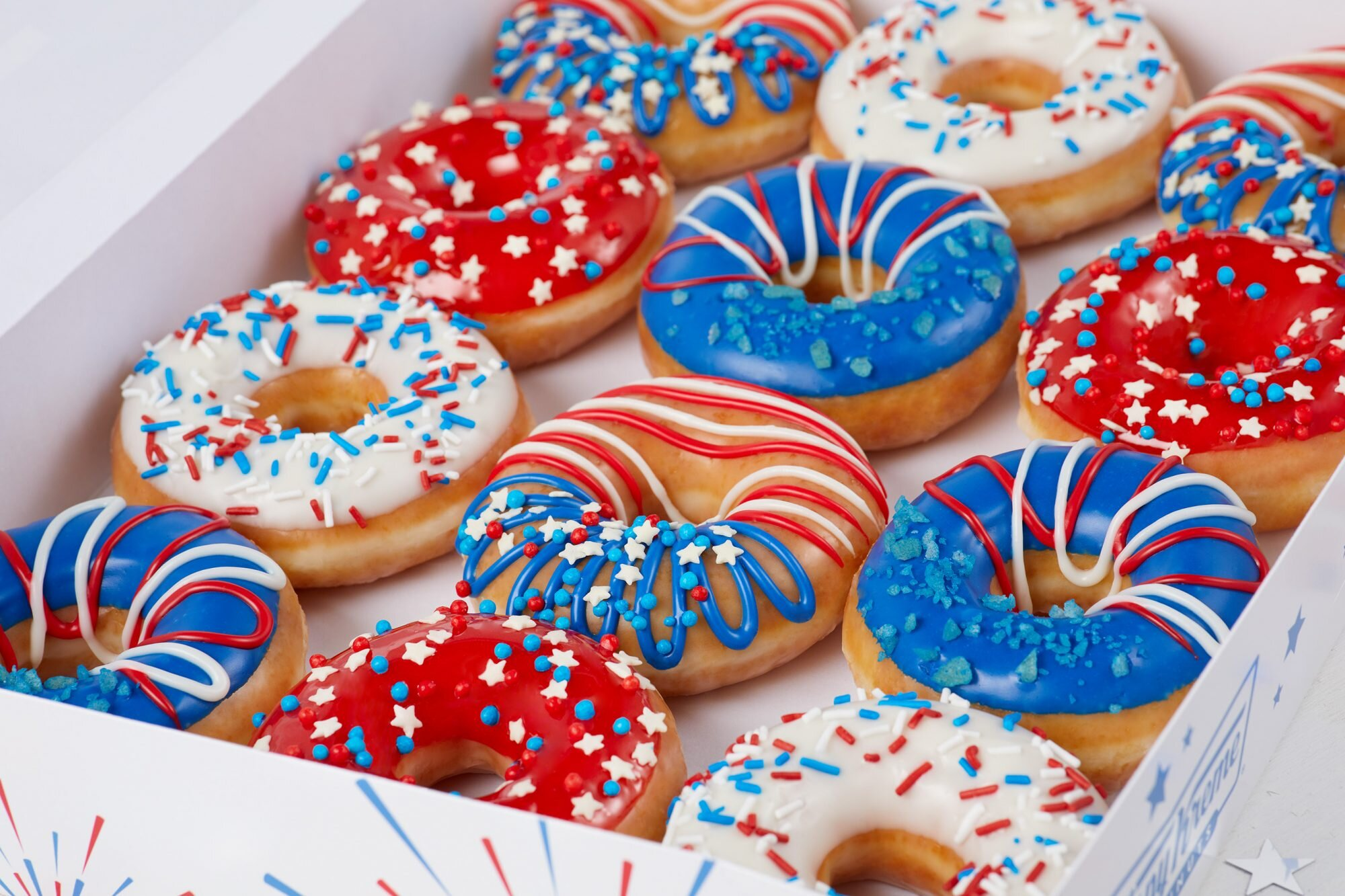 """Krispy Kreme's New """"Indoughpendence"""" Day Doughnuts Make the Holiday Even Sweeter"""