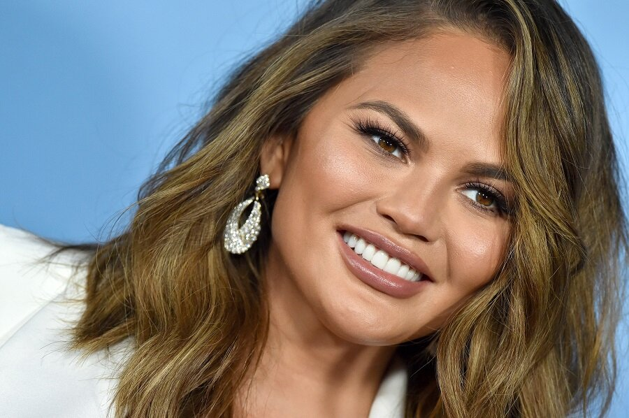 Chrissy Teigen revealed why she's getting her breast implants removed