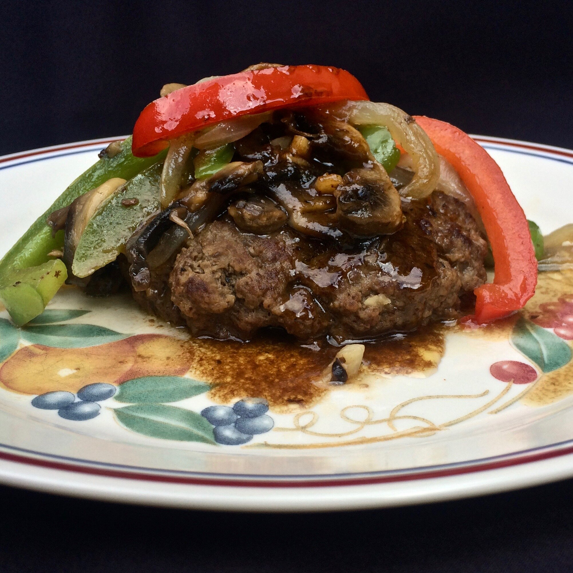 hamburger steaks with peppers onions and mushrooms