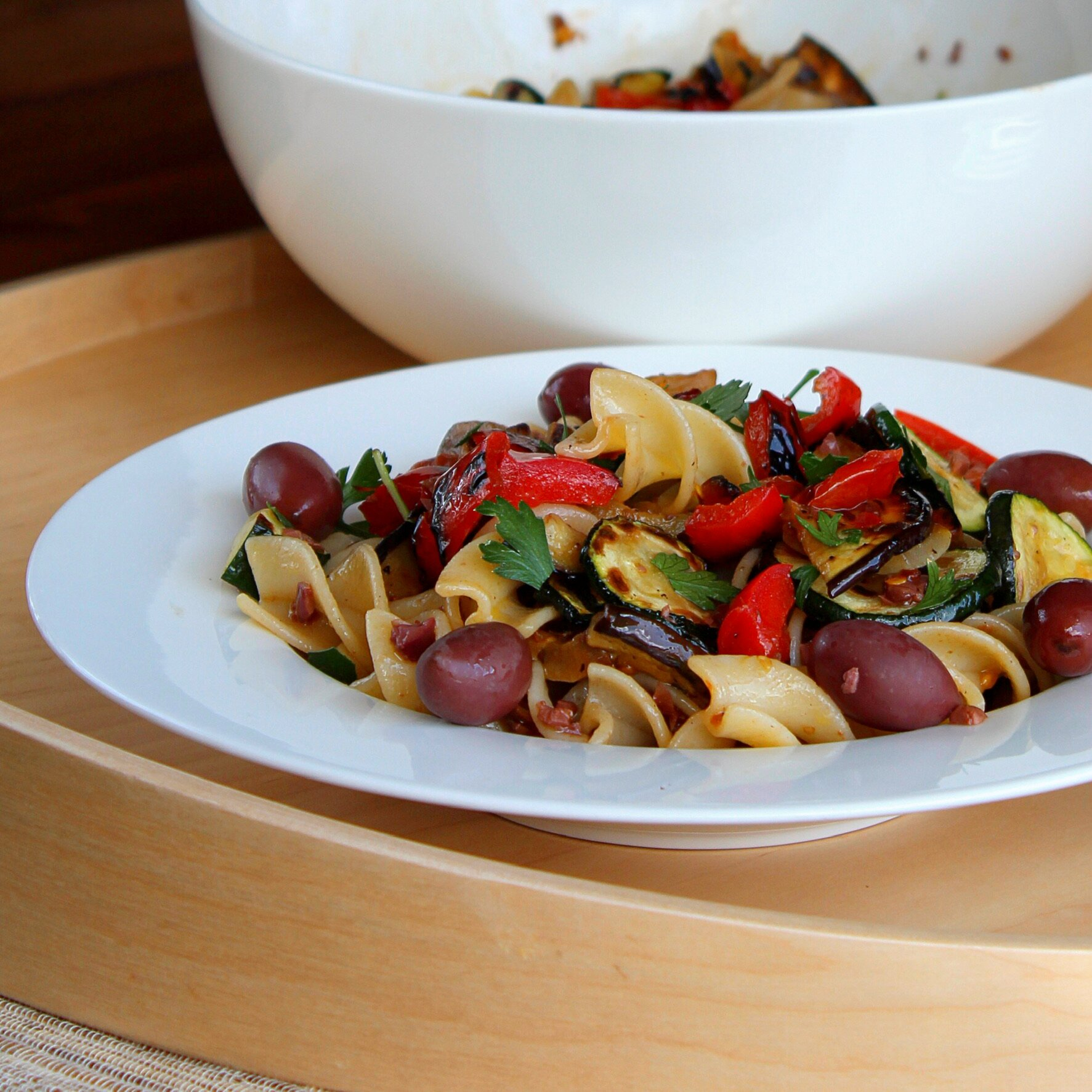 vegan italian pasta salad with vegetables and olives