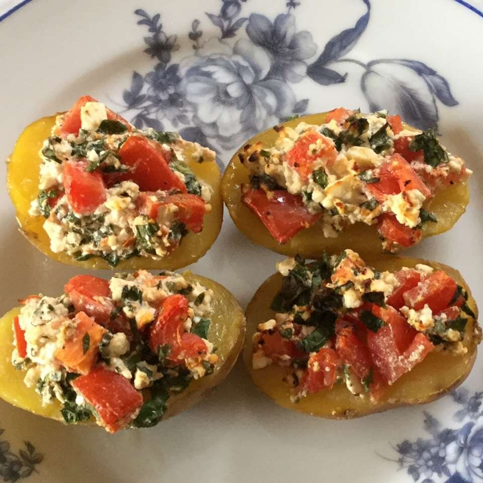 baked potatoes with ramps and feta