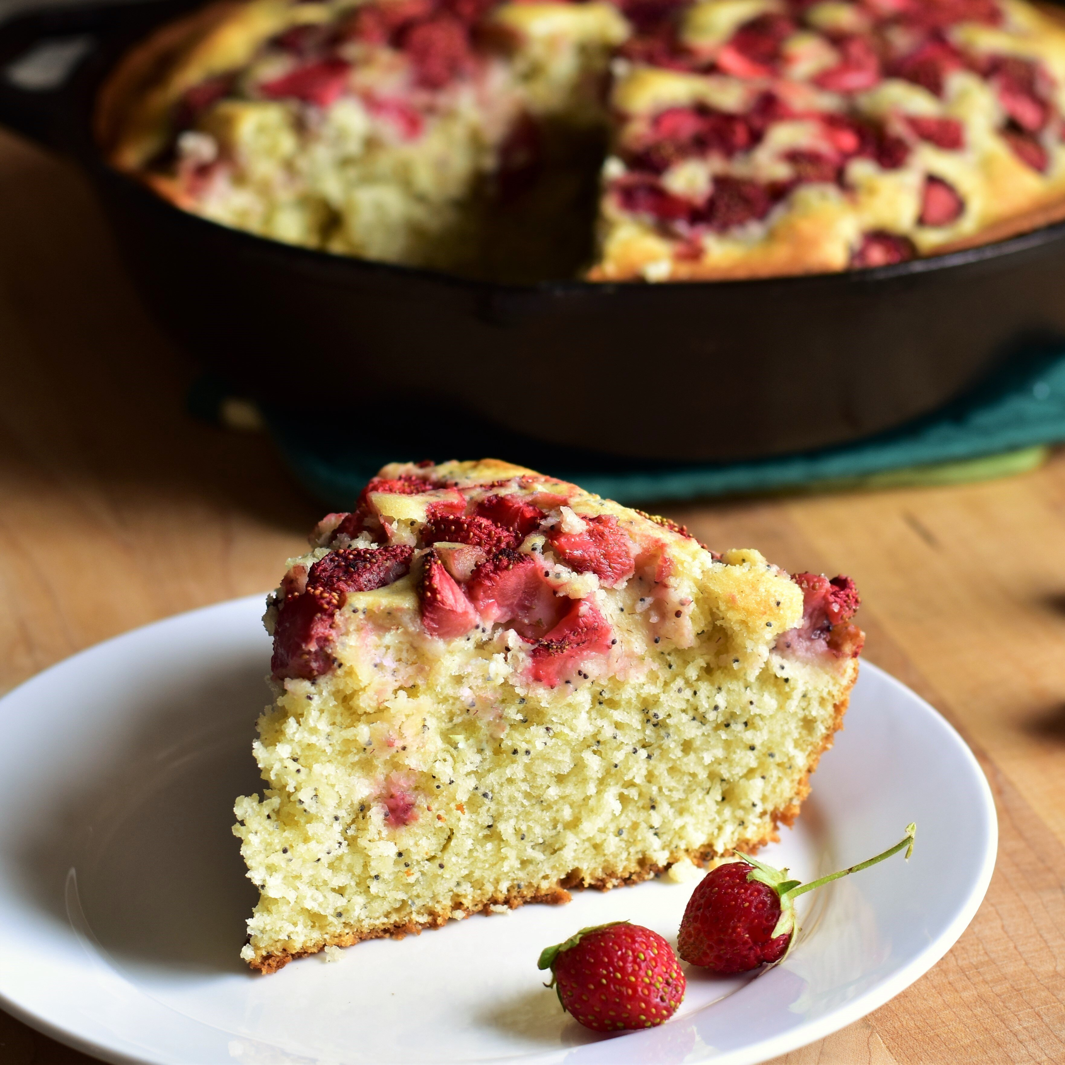 buttermilk poppy seed skillet cake with strawberries