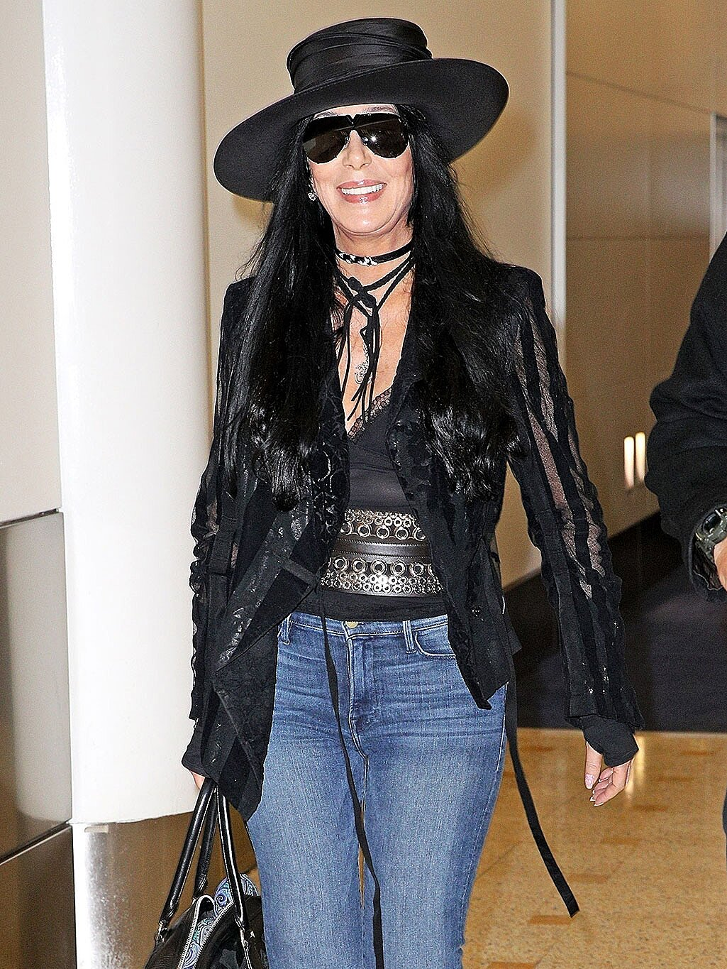 Cher S Best Airport Outfits Photos People Com