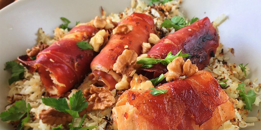 herby cauliflower rice with pecans and candied bacon wrapped