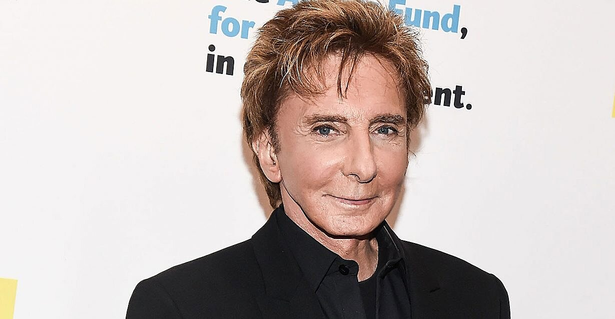 Graham norton admits barry manilow told him he was gay months before coming out