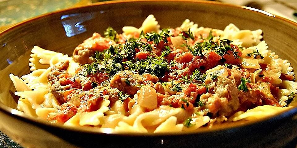 bow ties with sausage tomatoes and cream