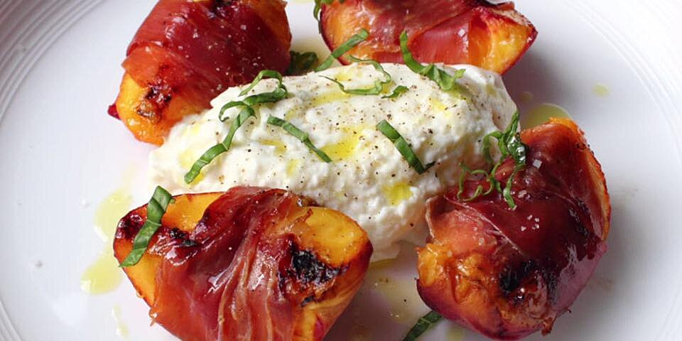 grilled prosciutto wrapped peaches with burrata and basil