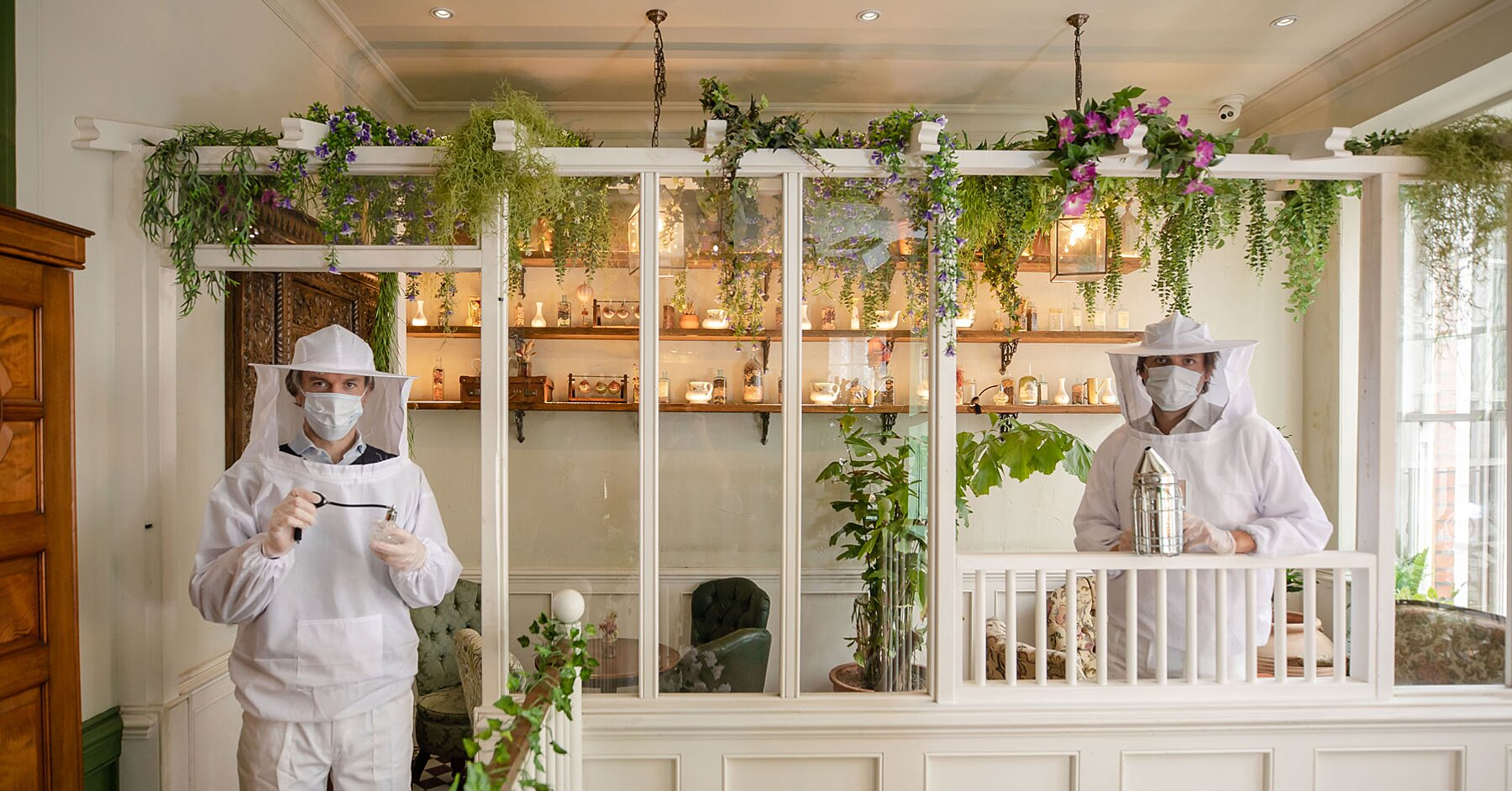 This London Bar Is Using Beekeeper Suits As Protective Gear for Employees