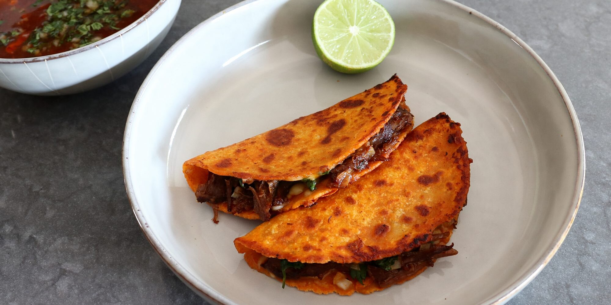 turn chef johns savory beef stew into delicious birria tacos on