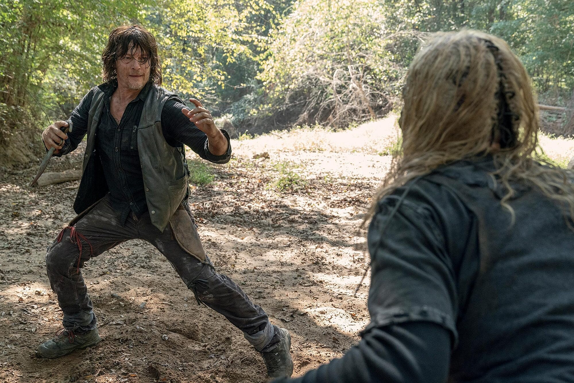 The Walking Dead: Norman Reedus on that bloody Daryl and Alpha battle    EW.com