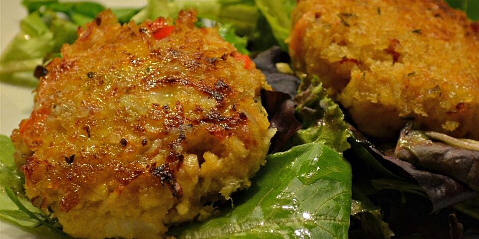 deviled crab cakes on mixed greens with ginger citrus vinaigrette