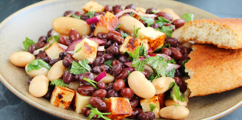 halloumi three bean salad with pomegranate harissa vinaigrette