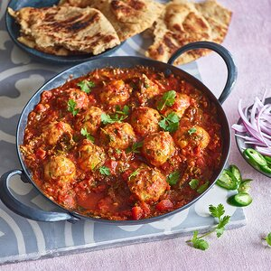 Chickpea Dumplings in Curried Tomato Sauce