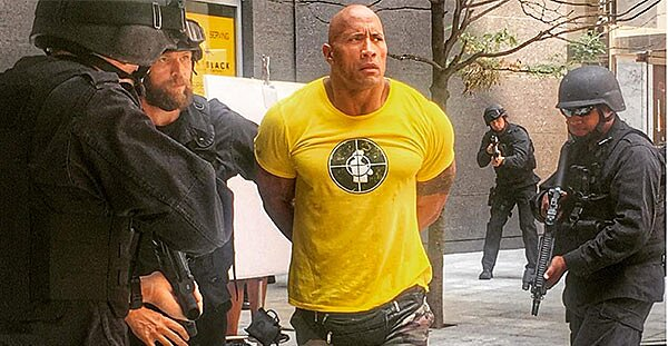 The Rock Wearing a Fanny Pack and Handcuffs: Photo