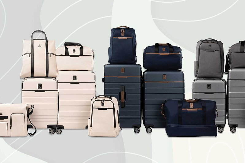 The collection of Travel + Leisure's luggage collaboration with TravelPro shows pieces in white, navy and grey