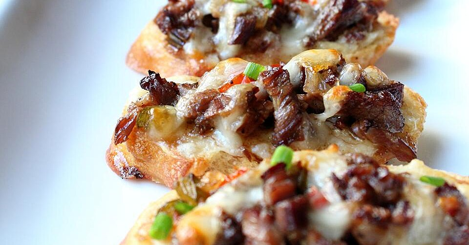 These 12 Philly Cheesesteak Mashups Are Game Day Essentials