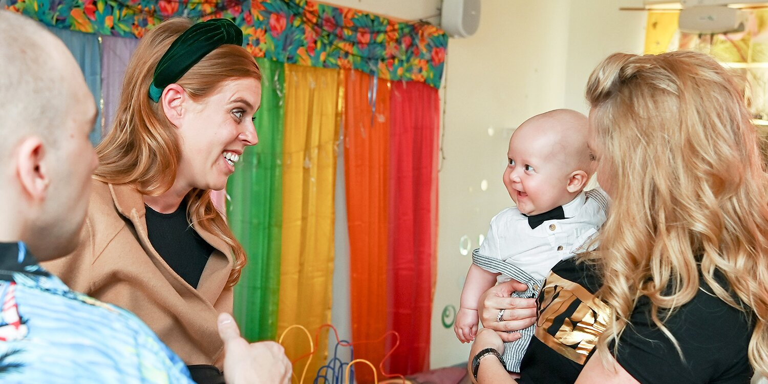 Royal Mom-to-Be Princess Beatrice Gets a Gigantic Grin from a Bowtie-Bedecked Baby During Charity Outing.jpg
