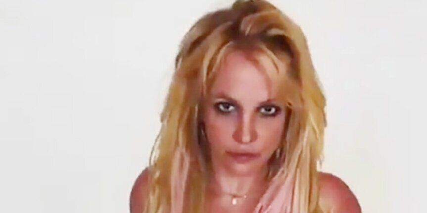 Britney Spears Shows Off Her 'Favorite' Tattoo That 'You Never See' While Wearing Neon Pink Swimsuit.jpg