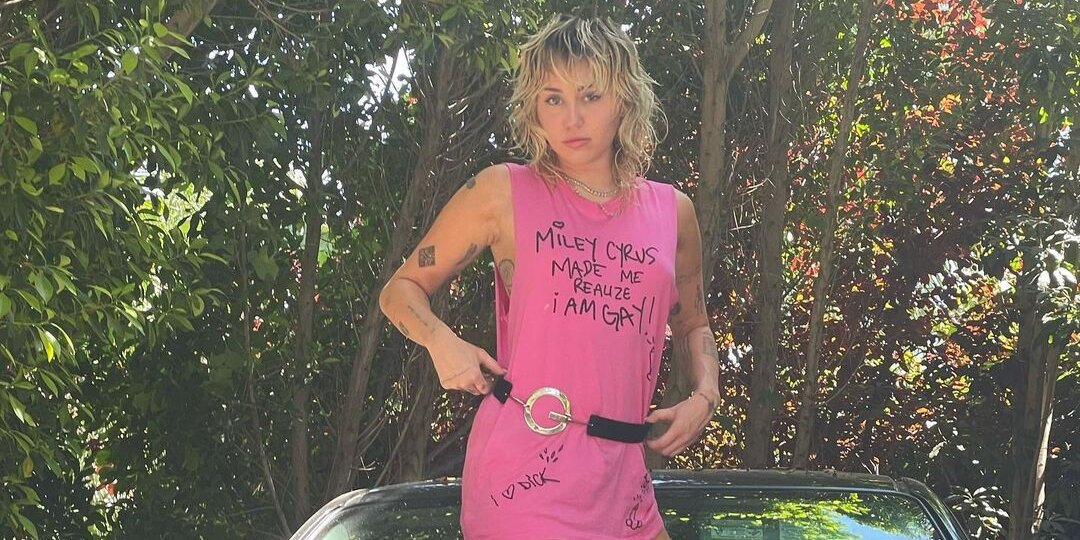 Miley Cyrus Poses on Dad Billy Ray Cyrus' Truck in NSFW Graphic Tee (and No Pants).jpg