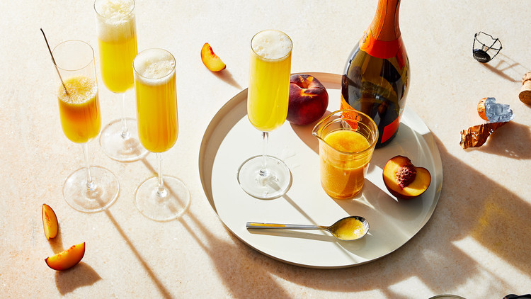 peach bellinis served in flutes