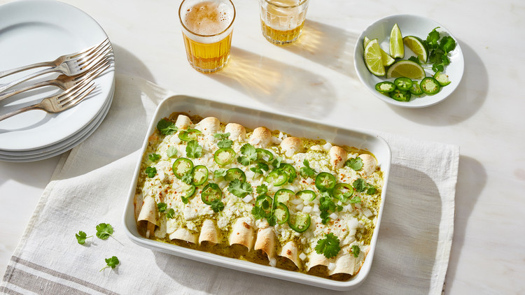 enchiladas suizas topped with jalapenos and cilantro