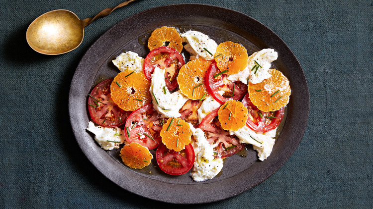 winter caprese salad topped with chives