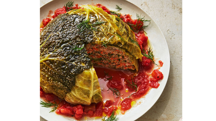 whole stuffed cabbage served on a white plate