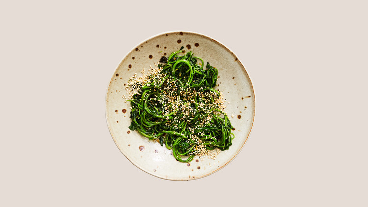 watercress stir-fry topped with sesame seeds