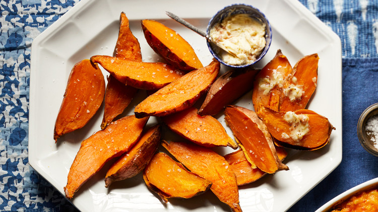 slow-baked sweet potatoes served on a white plate