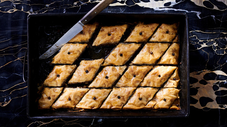 cut baklava with lemon honey syrup in pan
