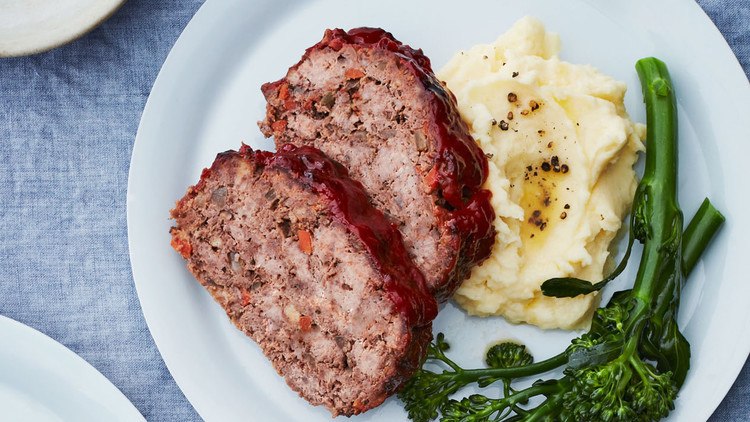 two plates of meatloaf potatoes and broccolini