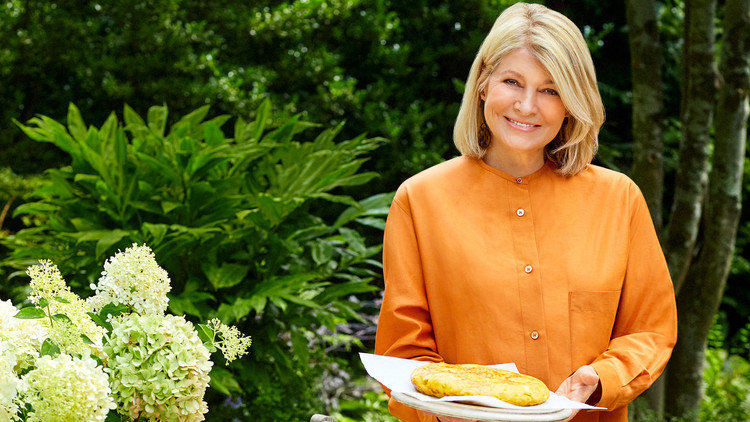 martha stewart holding tortilla espanola on patio
