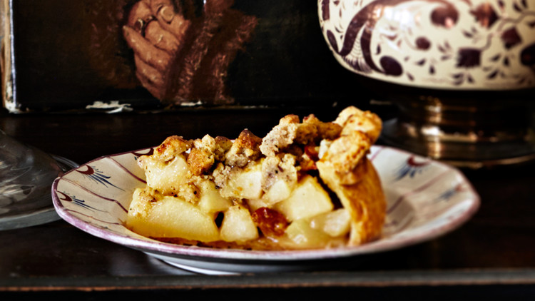 spiced pear pie with buckwheat crumble on a wooden tray
