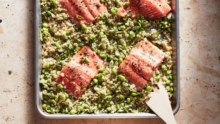 wild salmon with edamame cauliflower rice served in a pan