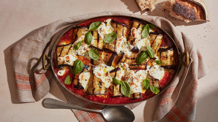 eggplant involtini with fresh tomato sauce topped with fresh basil leaves