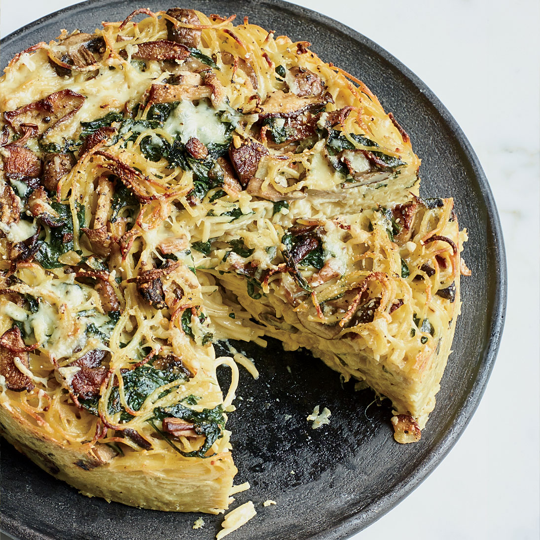 Spaghetti Pie with Wild Mushrooms and Spinach