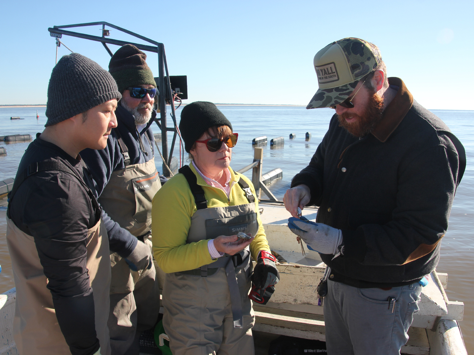Anita Arguelles and Chef Austin Sumrall inspect a catch.