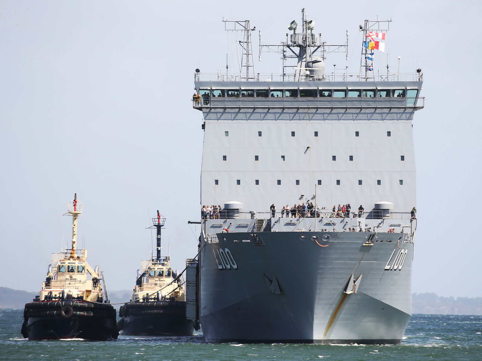 HMAS Choules arrives carrying evacuees from Mallacoota at the port of Hastings, Australia on January 4, 2020.