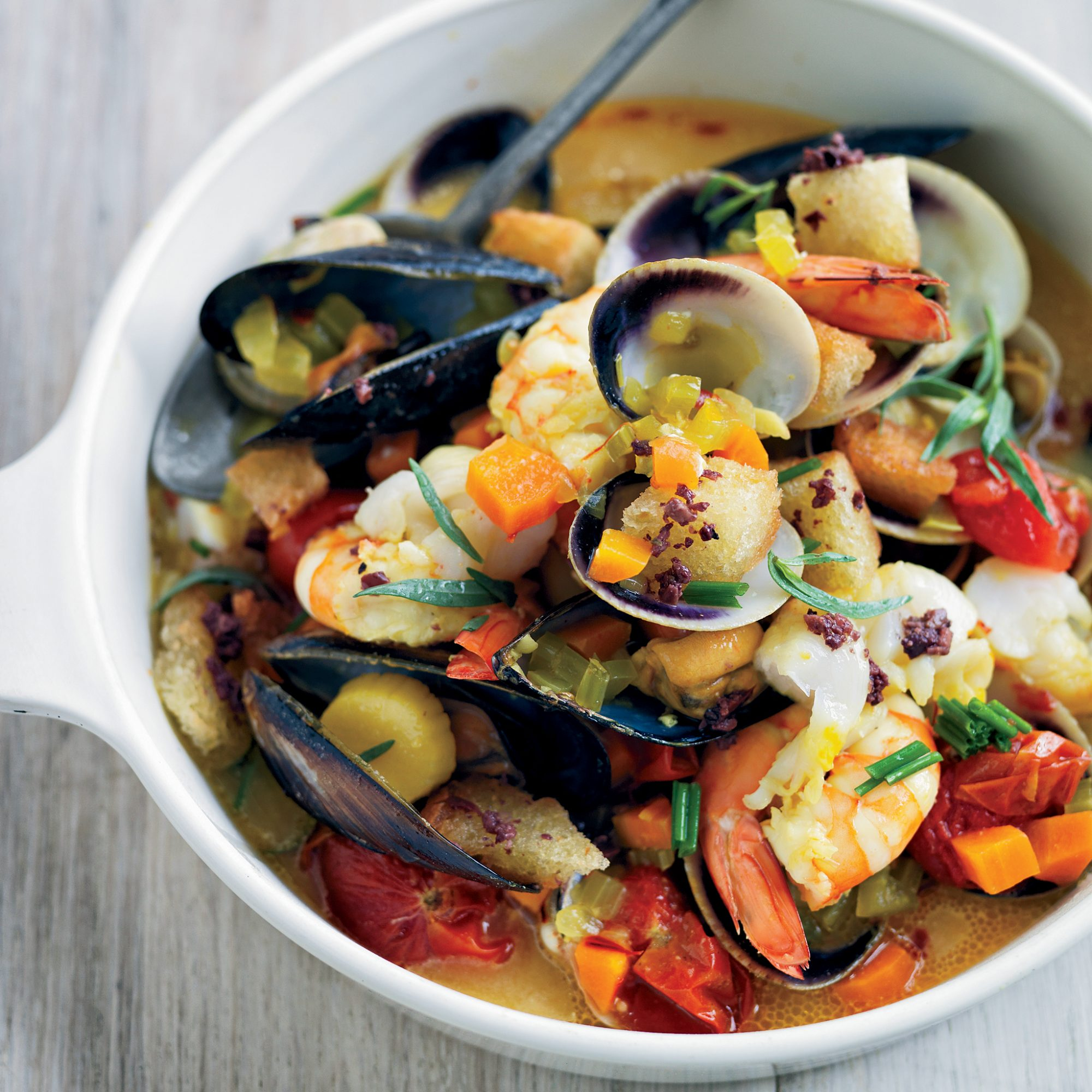 Saffron Shellfish Stew with Black Olive Croutons