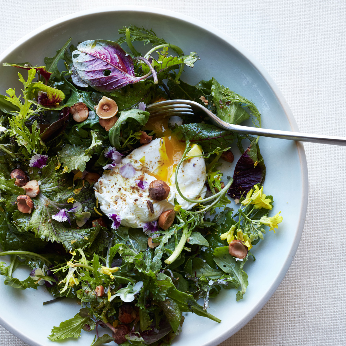 Mixed Greens with Poached Eggs, Hazelnuts and Spices